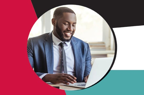 man of color on a laptop inside a designed circle of red, black and teal
